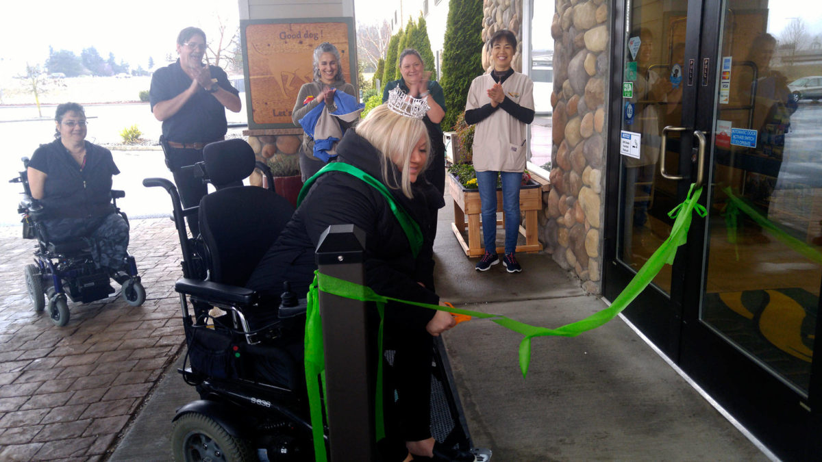 Ms. Wheelchair Washington Stacie Lee cuts the ribbon on new automated doors at Quality Inn & Suites in Sequim. WHW photo