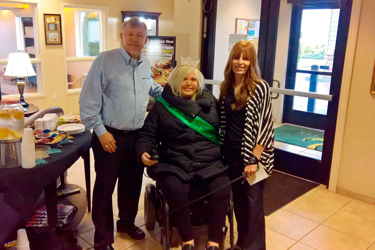 Ms. Wheelchair Washington Stacie Lee poses for a photo after cutting the ribbon at Sequim Quality inn & Suites with its owner Bret Wirta and General Manager Nancy Merrigan. WHW photo